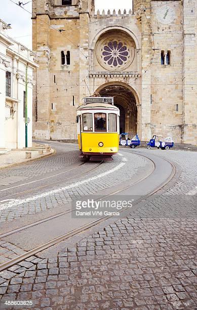 Historic yellow tram in Lisbon.