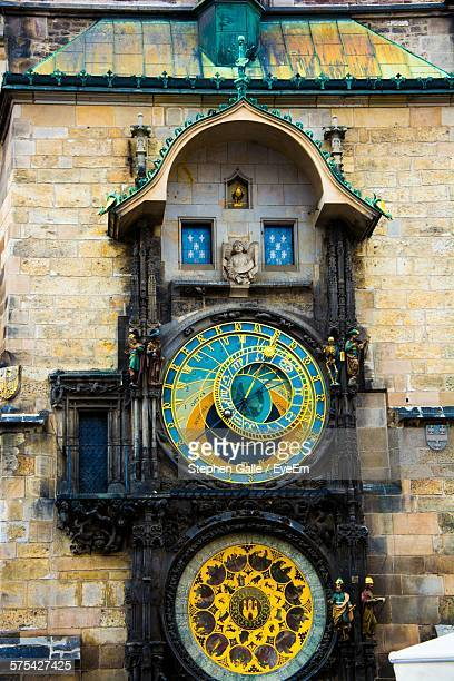 historical astronomical clock tower in city - astronomical clock prague stock pictures, royalty-free photos & images