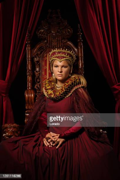 historical blonde saintly queen character on the throne - throne stock pictures, royalty-free photos & images