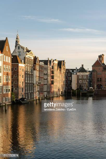 historical buildings of amsterdam in the sunset light. - amsterdam stock pictures, royalty-free photos & images