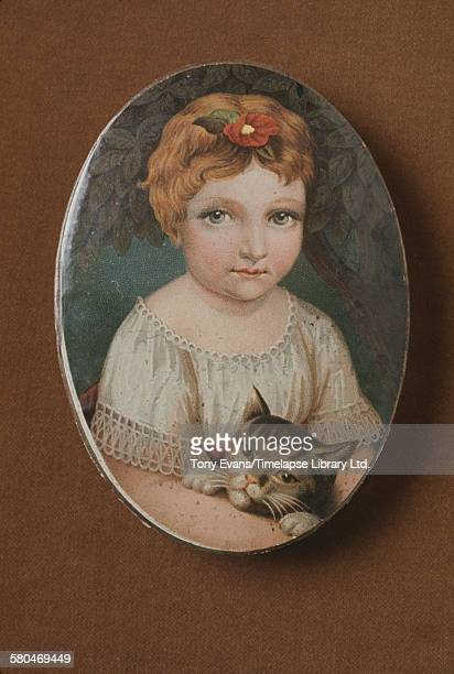 A historical Cadbury chocolate box featuring a painting of a child with a cat circa 1970
