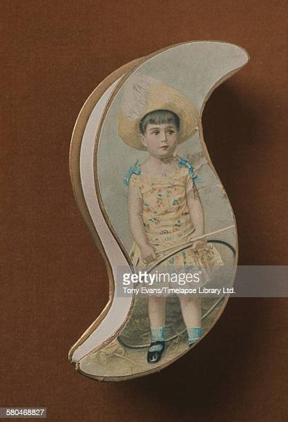 A historical Cadbury chocolate box featuring a painting of a girl with a hoop circa 1970