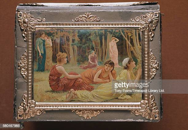 A historical Cadbury chocolate box featuring a painting of ancient Greek women at leisure circa 1970