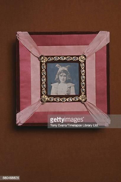 A historical Cadbury chocolate box featuring a photograph of a girl circa 1970