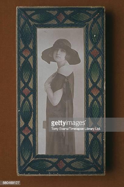 A historical Cadbury chocolate box featuring a photograph of a young woman circa 1970