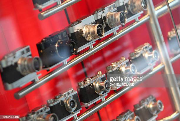 Historical cameras of German camera producing company Leica are on display at the production facility in Solms central Germany on October 24 2011 AFP...