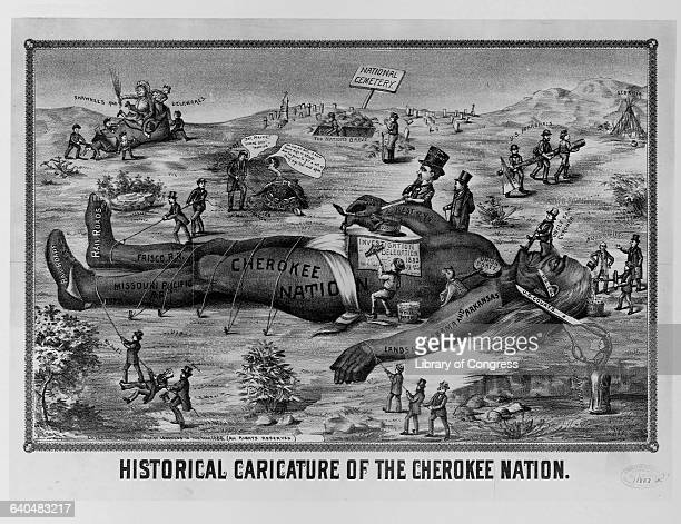 Historical caricature of a giant Cherokee Indian representing the Cherokee Nation tied down in the National Cemetery being destroyed by railroad...