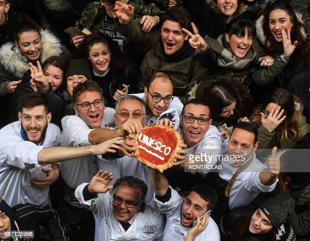 Historical center of Naples a group of Neapolitan pizza makers celebrate the positive outcome of the UNESCO such as «The art of Neapolitan pizzaiuolo...
