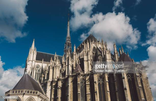 historical church against sky - oise stock photos and pictures