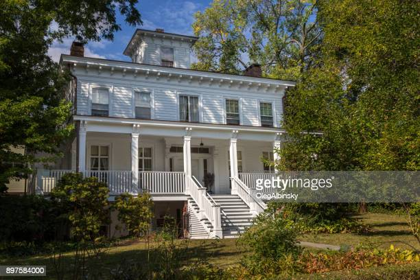Historical Colonial House with White Clapboard Exterior and Blue Sky, Nyack, Rockland County, Hudson Valley, New York.