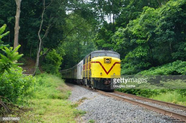 historical diesel locomotive pulls tourist on the scenic passenger train, cuyahoga valley national park, brecksville, ohio, usa - cuyahoga river stock photos and pictures