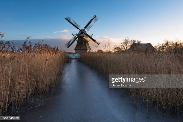Historical Dutch windmill during a winter morning