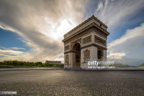 historical gate against cloudy sky during sunset - monument stock pictures, royalty-free photos & images