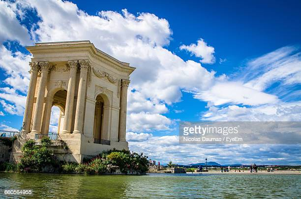 historical gate by lake at promenade du peyrou park - montpellier stock pictures, royalty-free photos & images