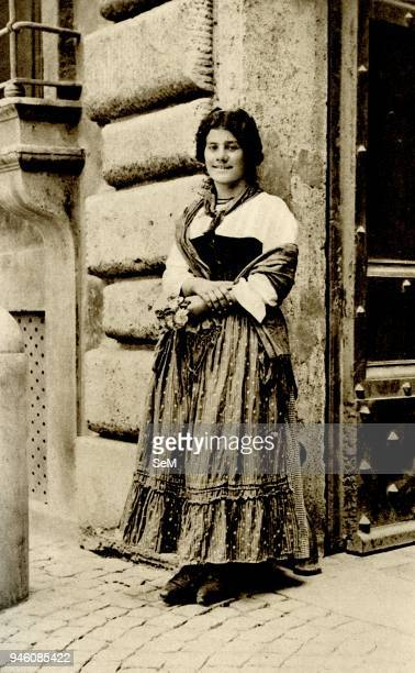Historical Geography 1900 Italy Dolce far niente In Roman sunshine a flower girl stands her nose gays all but vanished happy thoughts beguiling the...