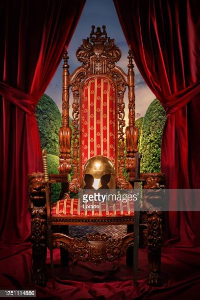 historical helmet on the throne in studio shoot - throne stock pictures, royalty-free photos & images