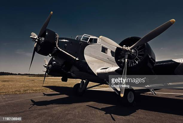 historical ju 52 aircraft. the junkers ju 52 was used as an civilian airliner and military aircraft manufactured between 1932 and 1945 by junkers corporation. - air vehicle stock pictures, royalty-free photos & images