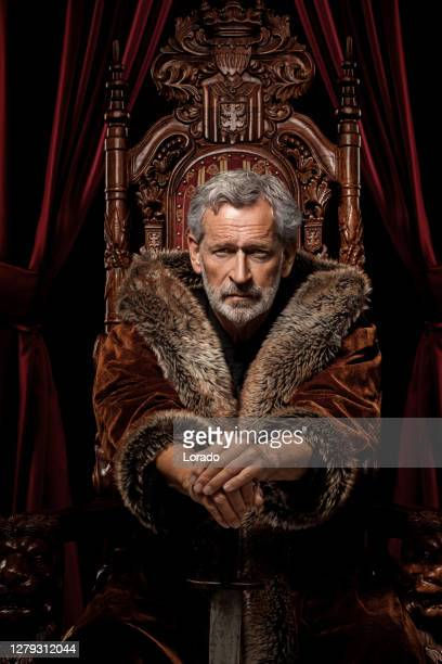 historical king on the throne in studio shoot - historical clothing stock pictures, royalty-free photos & images