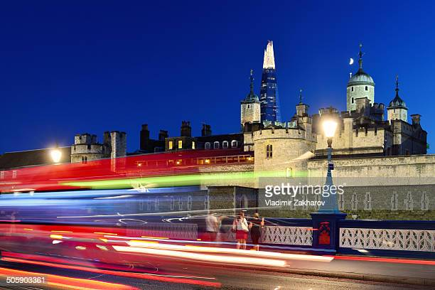 CONTENT] Historical landmark Tower of London and The Shard skyscraper with traffic trails light in front of it
