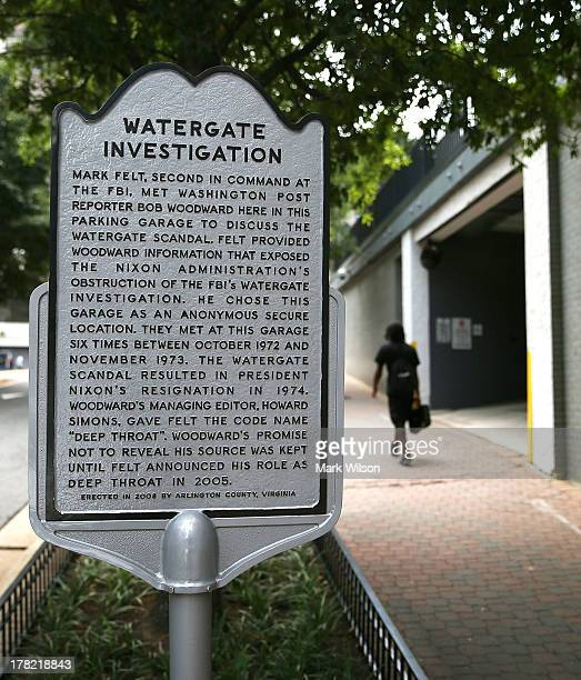 A historical marker stands next to the entrance of the parking garage where Washington Post reporter Bob Woodward held late night meetings with Deep...