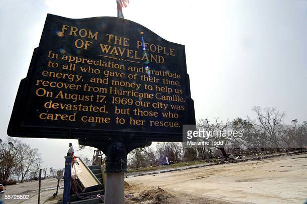 Historical marker thanking people for coming to aid after Hurricane Camille hit Waveland in 1969 sits amit a wiped out neighborhood left by Hurricane...