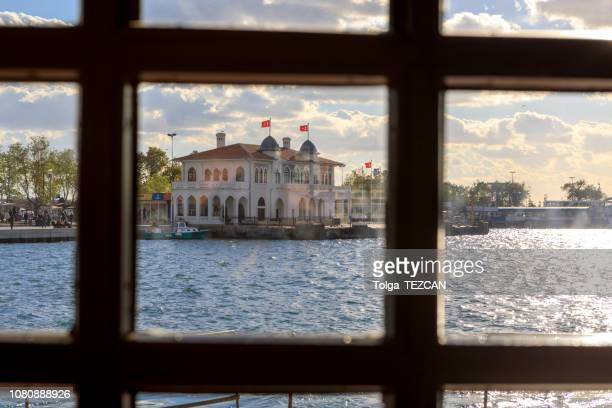 historical old besiktas and adalar port building - kadikoy stock photos and pictures