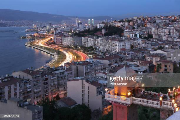 historical old elevator and distant izmir city  at dusk time. turkey - izmir stock pictures, royalty-free photos & images