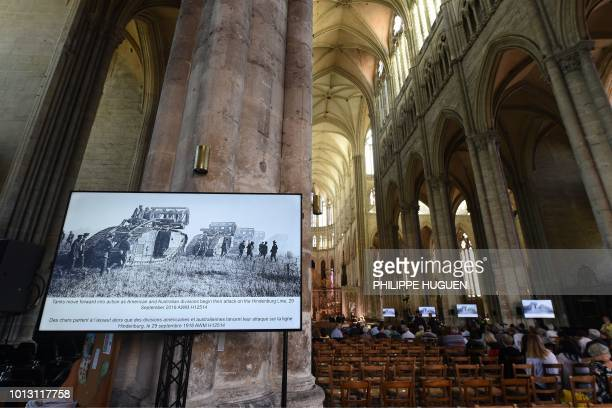 Historical photographs of the Battle of Amiens are displayed as guests arrive at the Cathedral Basilica of Our Lady in Amiens northern France on...