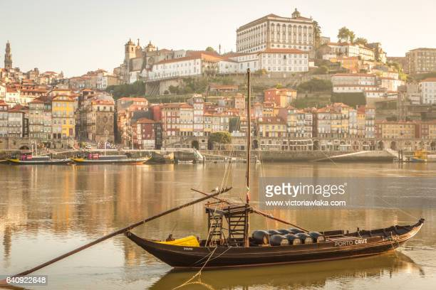 Historical Port Wine ship at river Douro with Oporto city in the background
