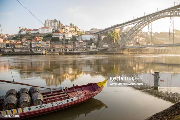 Historical Port Wine ship at river Douro with Ponte Luis I in Oporto, Portugal