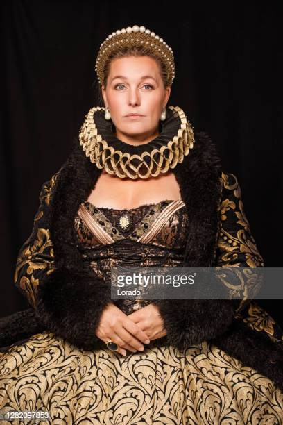 historical queen character in a studio shoot - queen royal person stock pictures, royalty-free photos & images
