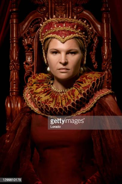 historical queen character in a studio shoot - historical clothing stock pictures, royalty-free photos & images