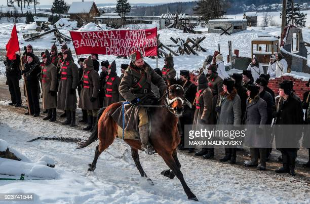 Historical reenactment enthusiasts dressed as Red Army's soldiers in 1920s take part in a reenactment battle marking the Defender of the Fatherland...