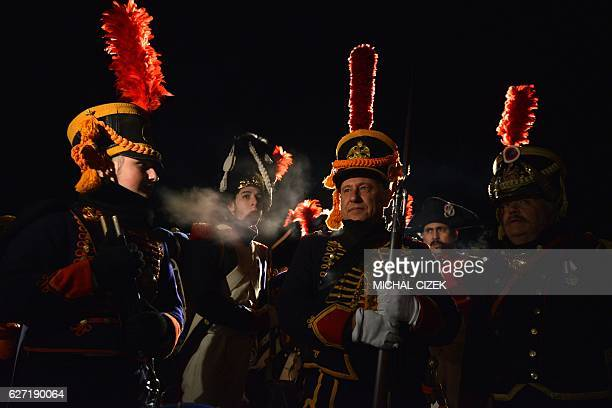 Historical reenactment enthusiasts dressed as soldiers stand guard in front of the Peace Memorial on Prace hill on December 2 2016 on the eve of an...