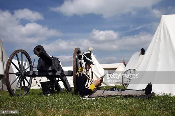 A historical reenactor in period costume rests in the Allied bivouac encampment on June 18 2015 in Waterloo Belgium Around 5000 historical reenactors...