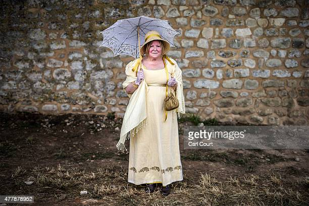 Historical reenactor Lizzy Spring from Derbyshire poses for a photograph in her role as a camp visitor in the Allied army ahead of the second part of...