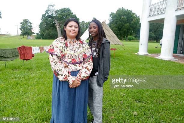 A historical reenactor poses with Rutina Wesley at the National Park Foundation's Parks 101 Experience at The MalusBeauregard House at the Chalmette...