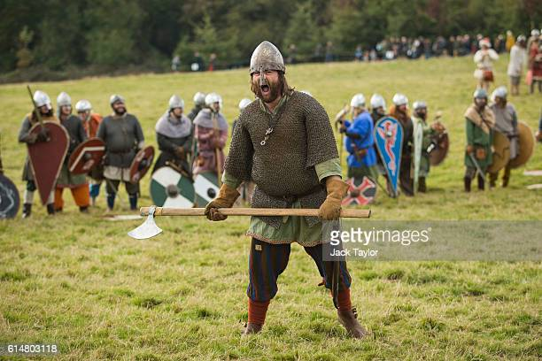 A historical reenactor roars as he takes part in a demonstration of battlefield tactics ahead of a reenactment of the Battle of Hastings on October...