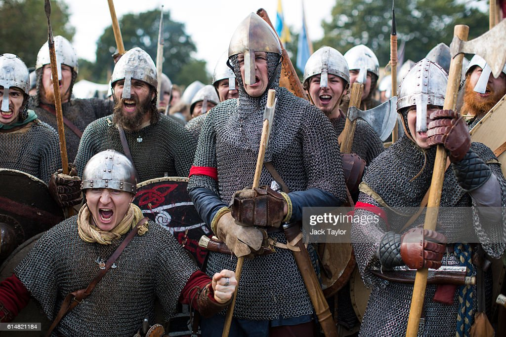 Historical re-enactors are pictured as they prepare to take part in a re-enactment of the Battle of Hastings on October 15, 2016 in Battle, England. Re-enactors have gathered on the site of the 1066 battle to mark the 950th anniversary of the battle between the Norman-French army of William, the Duke of Normandy, and the English army under the Anglo-Saxon King Harold II. King William's victory marked the beginning of the Norman conquest of England.