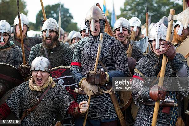 Historical reenactors are pictured as they prepare to take part in a reenactment of the Battle of Hastings on October 15 2016 in Battle England...