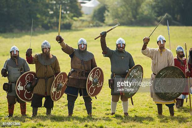 Historical reenactors cheer as they take part in a demonstration ahead of a reenactment of the Battle of Hastings on October 15 2016 in Battle...