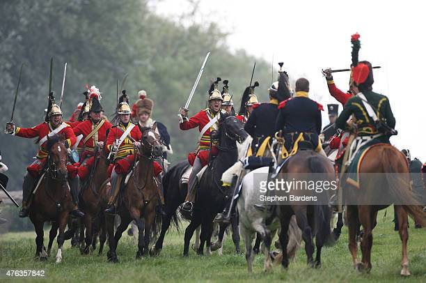 Historical reenactors dressed as British heavy cavalry participate in a cavalry charge during a Battle of Waterloo reenactment on June 17 2007 in...