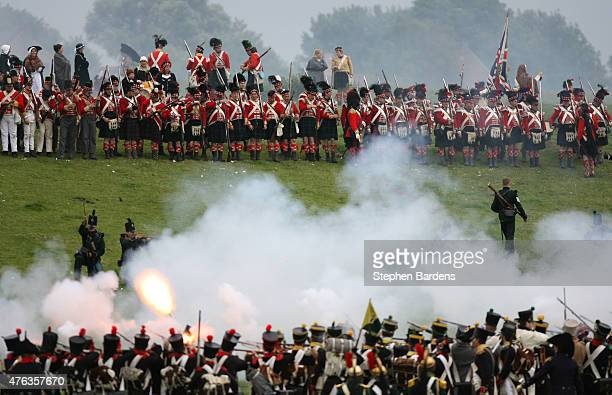 Historical re-enactors dressed as British Highlanders and French Infantry participate in a Battle of Waterloo Re-Enactment on June 16, 2007 in...