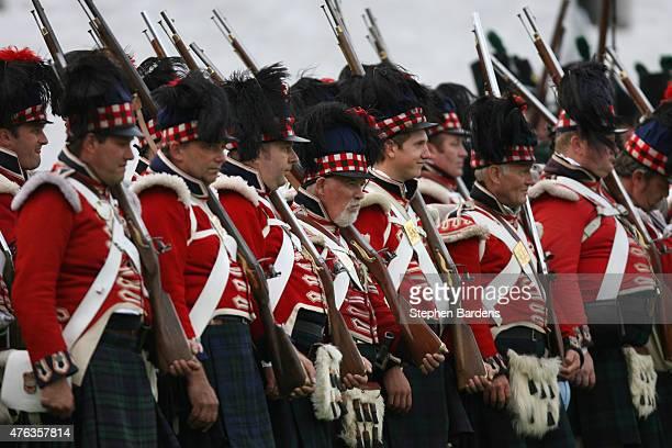 Historical reenactors dressed as British Highlanders participate in a Battle of Waterloo ReEnactment on June 16 2007 in Waterloo Belgium