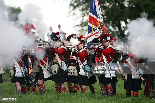 Historical reenactors dressed as British Highlanders participate in a Battle of Waterloo reenactment on June 17 2007 in Waterloo Belgium