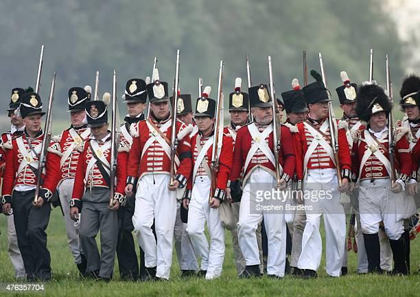 Historical reenactors dressed as British Infantry participate in a Battle of Waterloo reenactment on June 17 2007 in Waterloo Belgium