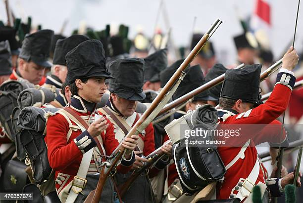 Historical reenactors dressed as British Line infantry participate in a Battle of Waterloo ReEnactment on June 16 2007 in Waterloo Belgium