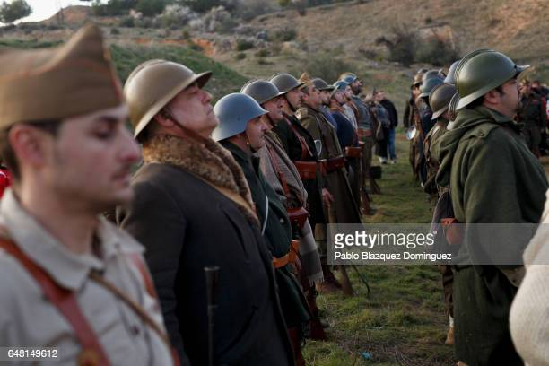 Historical reenactors dressed as the International Brigades and Republicans line up after a reenactment of the Battle of Jarama to mark its 80...
