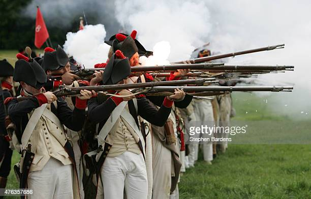 Historical reenactors dresses as French infantry fire their muskets as they participate in a Battle of Waterloo reenactment on June 17 2007 in...