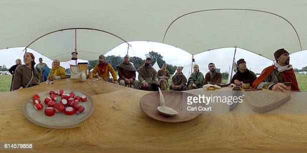Historical reenactors eat lunch ahead of a reenactment of the Battle of Hastings on October 14 2016 in Battle England Reenactors have gathered on the...